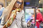 young-fashionable-woman-reading-sms-10086812