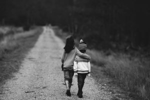 Parentification happening to a young child as she is parenting her younger sibling.